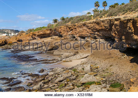 Rock coast at the Atlantic near Luz, west of Lagos, Algarve, Portugal, Europe - Stock Photo