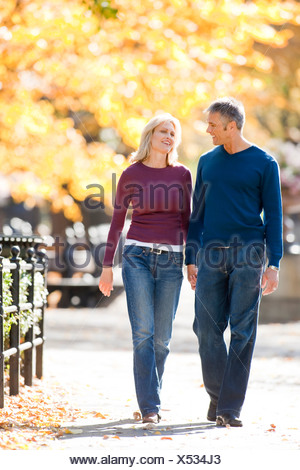 Couple walking outdoors - Stock Photo