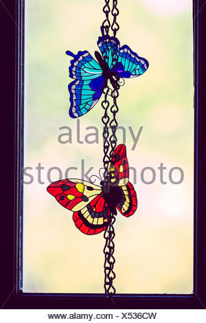 Artificial Butterflies On Chain - Stock Photo