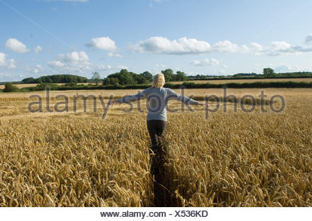 Woman on field - Stock Photo