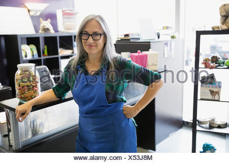 Portrait of dog daycare owner at counter - Stock Photo