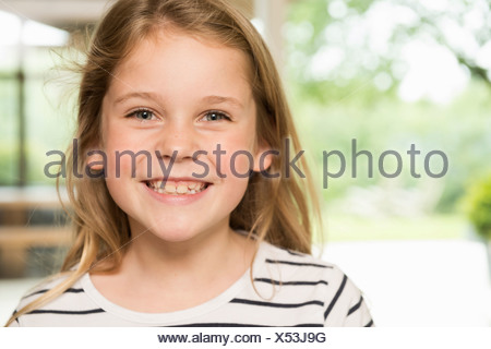 Girl with wide smile - Stock Photo