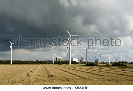 Wind turbines against dark storm clouds, Husum, Schleswig-Holstein - Stock Photo