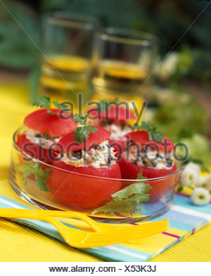 Tomatoes stuffed with tuna and capers - Stock Photo