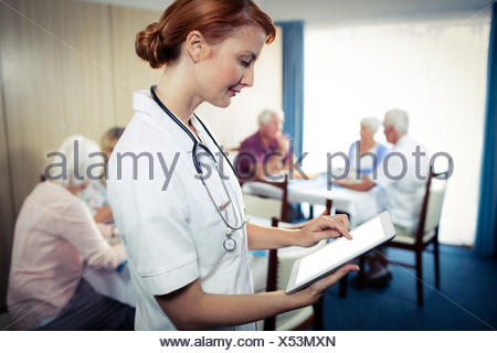 Portrait of a nurse with tablet computer - Stock Photo