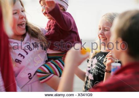 Laughing children, lake Worthsee, Bavaria, Germany - Stock Photo
