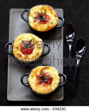 Cherry tomato and goat's cheese savoury puddings - Stock Photo