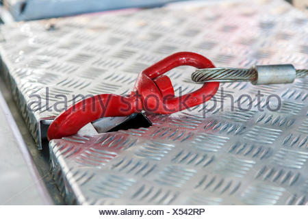 Secure truck load hook with a steel cable - Stock Photo