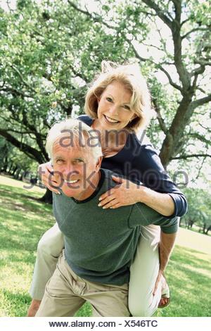 A senior couple fooling around - Stock Photo