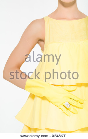 Woman wearing rubber gloves and a diamond ring - Stock Photo