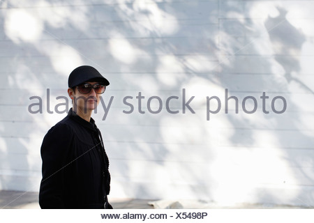 Woman walking outdoors - Stock Photo
