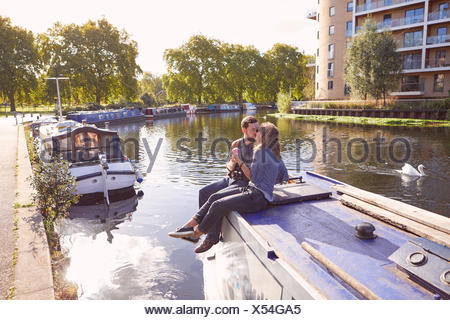 Couple on canal boat - Stock Photo