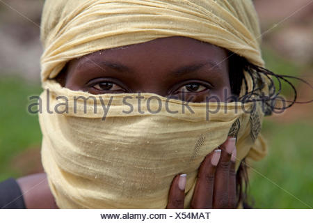 Portrait of a young woman with a headscarf, Uganda, Jinja - Stock Photo
