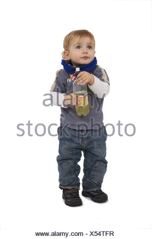 little boy with a plastic bottle in his hands - Stock Photo
