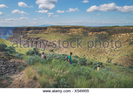 Father and two children hiking - Stock Photo
