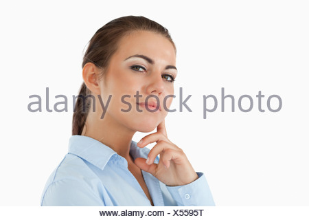 Side view of thinking young businesswoman - Stock Photo