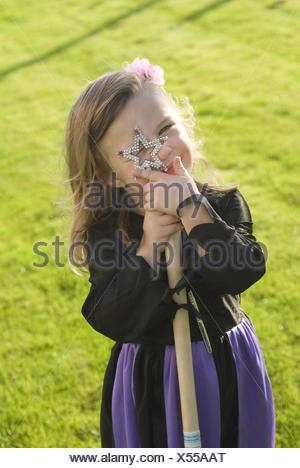 Girls, witch's costume, magic wand, - Stock Photo