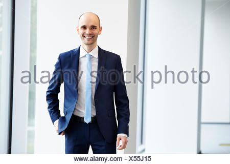 Cheerful young businessman in the office - Stock Photo