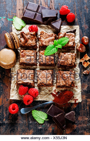 homemade brownie pieces on the board, food closeup - Stock Photo