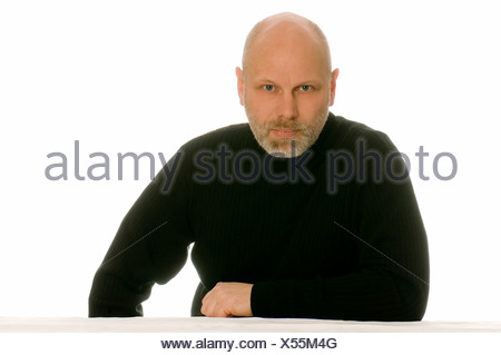 Portrait of middle-aged bald angry man against white background - Stock Photo