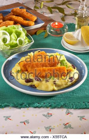 Fish Fingers with Mexican Mashed Potatoes - Stock Photo