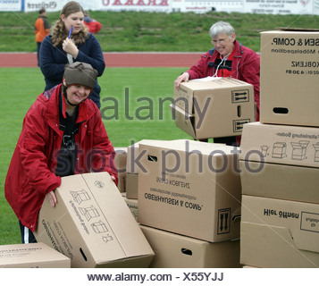 Handicapped People with cardboard box - Stock Photo