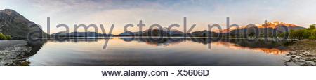 Sunrise, morning atmosphere, mountains reflected in Wanaka Lake, Rocky Peak, Glendhu Bay, Otago, Southland, New Zealand - Stock Photo