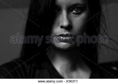Close-Up Portrait Of Thoughtful Young Woman At Home - Stock Photo