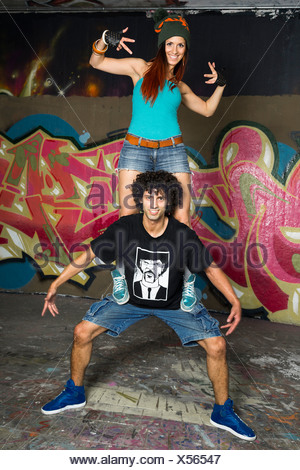 Germany, Stuttgart, Hall of Fame, Two Hip Hop dancers at airbrush wall - Stock Photo