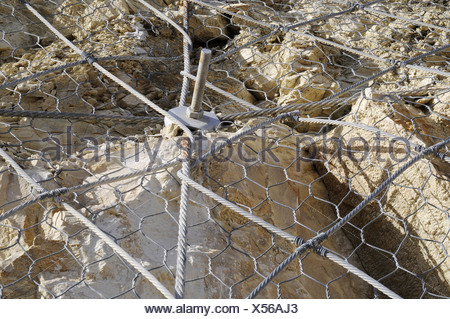 Mounting against rockfall - Stock Photo