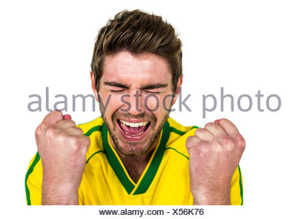 Handsome man rejoicing - Stock Photo