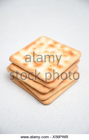 Cracker biscuits isolated on a kitchen bench. - Stock Photo