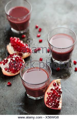 Ripe pomegranates with juice - Stock Photo