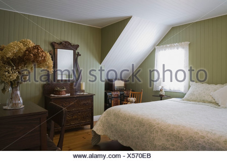 Guest bedroom of 19th century cottage style home quebec canada stock photo