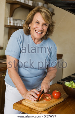 Woman preparing a salad - Stock Photo