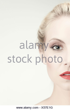 Half face of young woman - Stock Photo