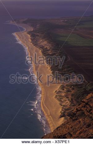 Polihale Beach and Polihale State Park, seen from Polihale ridge, west Kauai, late afternoon. Hawaii's longest white sand beach - Stock Photo