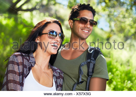 Smiling couple in woodlands - Stock Photo