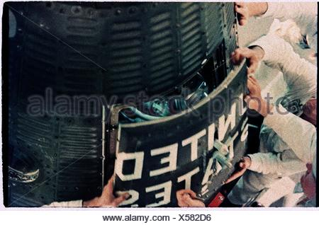Astronaut Alan Shepard is about to become the first American in space as technicians shut the hatch of his FREEDOM 7 capsule. - Stock Photo