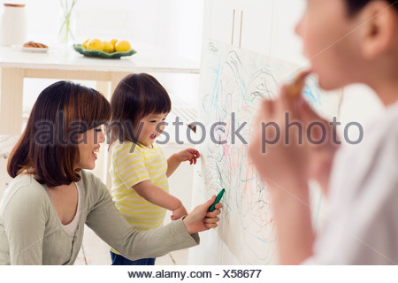 Mother and daughter having fun drawing - Stock Photo