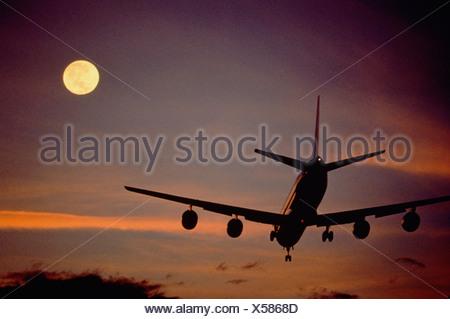USA. Denver. Colorado. Passenger jet aircraft landing at dusk. - Stock Photo