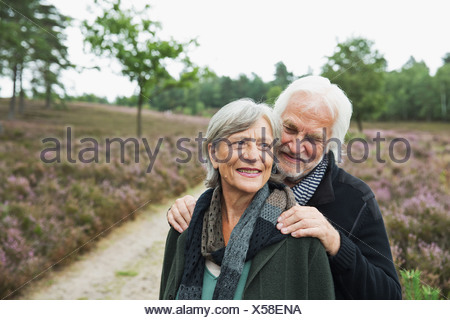 Senior couple, man with hands on woman's shoulders - Stock Photo