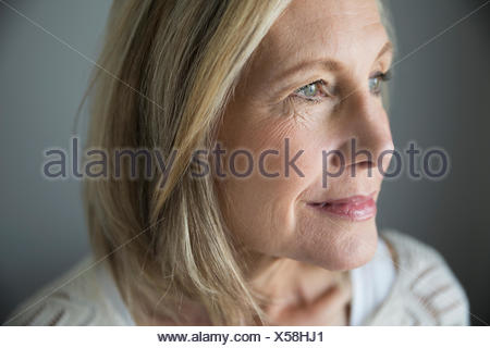 Close up portrait pensive senior woman looking away - Stock Photo