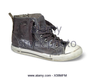 a old brown sneaker in white back - Stock Photo