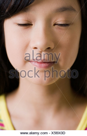 A girl with her eyes closed. - Stock Photo