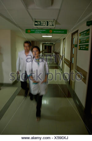 Doctors in a rush - Stock Photo