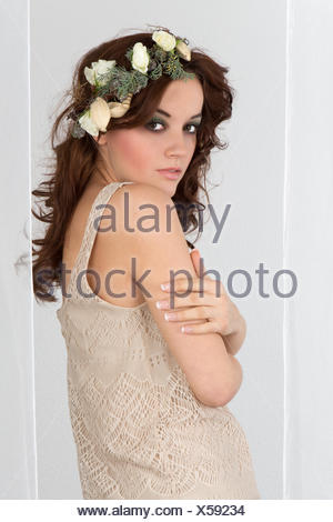 Young woman with flower arrangement as a headdress - Stock Photo