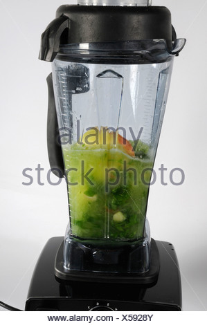 Production of green smoothie - Stock Photo