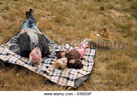 grandfather and granddaughter at picnic - Stock Photo