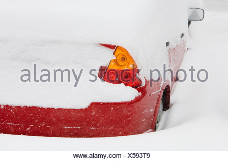 Car buried in snow in winter - Stock Photo